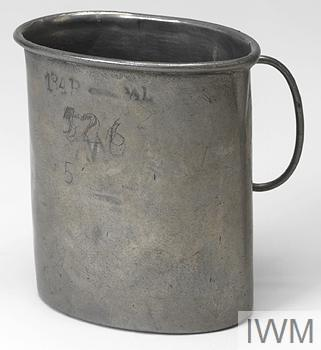 Metal cup associated with Mrs L M E Hollingdale's experiences as a prisoner of war